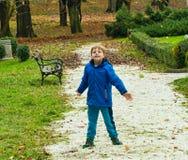 Boy throwing pebbles Stock Photos