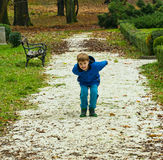 Boy throwing pebbles Stock Images
