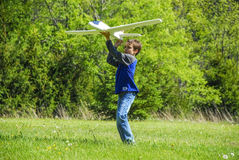 Boy Throwing Plane Royalty Free Stock Photography