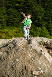 Boy throwing rock Stock Photo