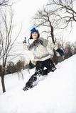 Boy throwing snow. Stock Photos