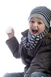 Boy throwing a snow ball Stock Images