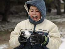 BOY THROWING A SNOWBALL Stock Photos