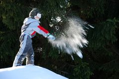 Boy Throwing a Snowball Royalty Free Stock Photography