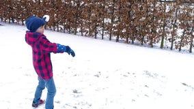 Boy throwing a snowball stock video