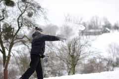 Boy throwing snowballs Stock Photos