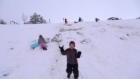 Boy throwing snowballs at camera stock video footage