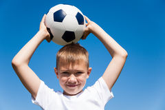 Boy throws a ball Royalty Free Stock Photos