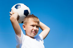 Boy throws a ball for football. Stock Photo