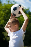 Boy throws the ball out Stock Photo