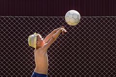 Boy throws the ball into the ring royalty free stock photography