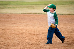 Boy throws baseball Royalty Free Stock Image