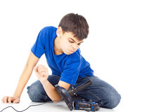 Boy throws joysticks Royalty Free Stock Photo