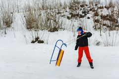 The boy throws sleds, the movement is imprisoned royalty free stock photography