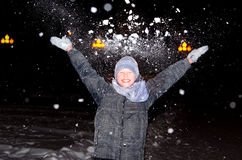 Boy throws up an armful of snow Royalty Free Stock Images