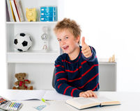 Boy with thumb up. Learning boy with thumb up Royalty Free Stock Photos