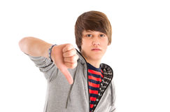 Boy thumbs down isolated on white Royalty Free Stock Images