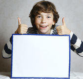 Boy with thumbs up hold blank paper sheet Royalty Free Stock Photos