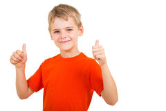 Boy thumbs up. Young boy showing thumbs up gesture isolated on white background stock photo