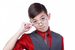 Boy tipping glasses down on his face. Royalty Free Stock Photos