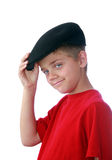 Boy tippinghis hat. Tween boy in red shirt tilting his hat, isolated on white Stock Photography