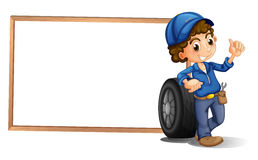 A boy and a tire beside an empty frame Royalty Free Stock Photo