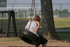 Boy on Tire Swing Royalty Free Stock Images