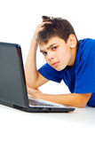 Boy tired of the computer Stock Photo