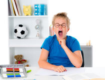 Boy is tired by the homework. Not to be in the mood for home work Stock Images