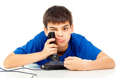 Boy tired of playing on the joystick Royalty Free Stock Image