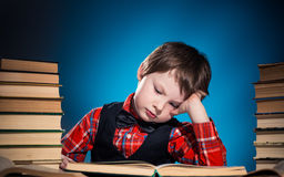 Boy tired of reading book Royalty Free Stock Photos