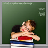 Boy Tired at School. Small elementary boy resting head on books with chalkboard graphic in the background Stock Photography