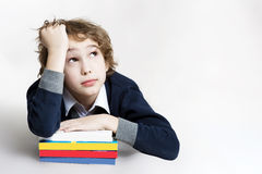 Boy is tired to read his books Stock Photo