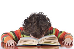 Boy tired to study. Adorable boy tired to study a over white background Royalty Free Stock Image