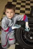 Boy and tires Royalty Free Stock Image