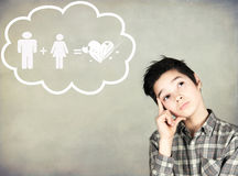 Boy to reflect on love. Boy in love to think about love and couple Stock Images