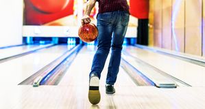 Boy about to roll a bowling ball hobby and leisure concept Stock Images