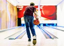Boy about to roll a bowling ball hobby and leisure concept Stock Image