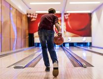 Boy about to roll a bowling ball hobby and leisure concept royalty free stock photos