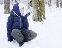 Boy About To Throw Snowball. Boy play in the winter forest Stock Photo
