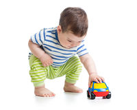 Boy toddler playing with toy car Stock Photos