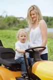Boy Toddler Sitting on Lawn Tractor Stock Photo