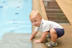 Boy todler touch the water Stock Images