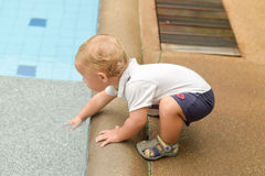 Boy todler touch the water Royalty Free Stock Photos
