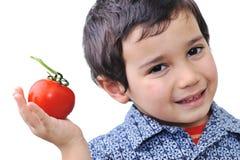 Boy with Tomato Stock Photos