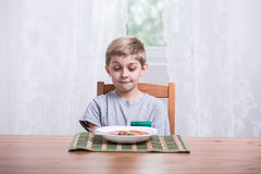 Boy with tomato soup Royalty Free Stock Image