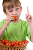 Boy with tomatoes Stock Photo