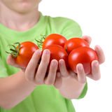 Boy with tomatoes Stock Image