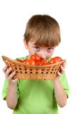 Boy with tomatoes Royalty Free Stock Images