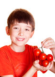 Boy with tomatoes. Isolated on white royalty free stock image